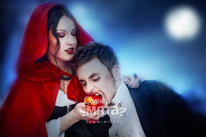 Девушка дает вампиру яблоко, фото